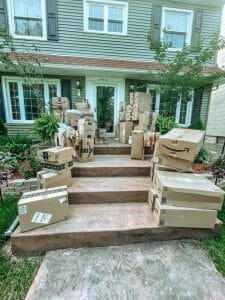 Dozens of packages on front porch.